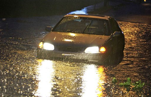 A small car gets stuck on a flooded roadway near Rudee inlet  as Hurricane Irene hits Virginia Beach , Va., Saturday, Aug. 27, 2011. Irene knocked out power and piers in North Carolina, clobbered Virginia with wind and churned up the coast Saturday to confront cities more accustomed to snowstorms than tropical storms.   <span class=meta>(AP Photo&#47; Steve Helber)</span>