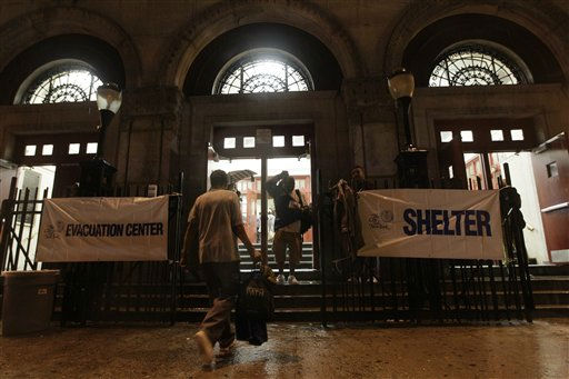 People arrive at a shelter on the Lower East Side neighborhood of Manhattan, Saturday, Aug. 27, 2011.  Mayor Bloomberg advised all New Yorkers to prepare as the region girded for wind, rain, and flooding as Hurricane Irene stands poised to bear down on an already saturated New York state.  <span class=meta>(AP Photo&#47; Mary Altaffer)</span>