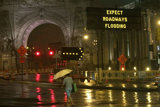 A road sign warns of inclement weather caused by Hurricane Irene as a pedestrian crosses Canal St. in front of the Manhattan bridge  in Lower Manhattan, Saturday, Aug. 27, 2011.  Mayor Bloomberg advised all New Yorkers to prepare as the region girded for wind, rain, and flooding as the storm stood poised to bear down on an already saturated New York state.  <span class=meta>(AP Photo&#47; Mary Altaffer)</span>