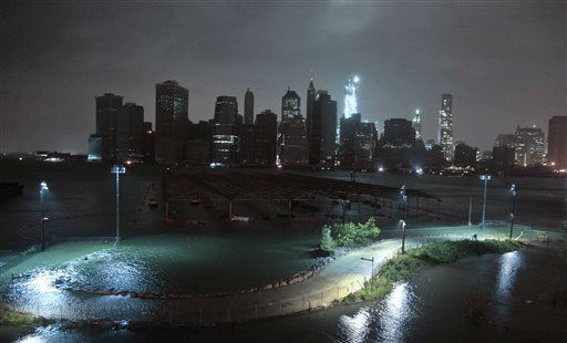Lower Manhattan goes dark during hurricane Sandy, on Monday, Oct. 29, 2012, as seen from Brooklyn, N.Y. Sandy continued on its path Monday, as the storm forced the shutdown of mass transit, schools and financial markets, sending coastal residents fleeing, and threatening a dangerous mix of high winds and soaking rain.? <span class=meta>(AP Photo&#47; Bebeto Matthews)</span>