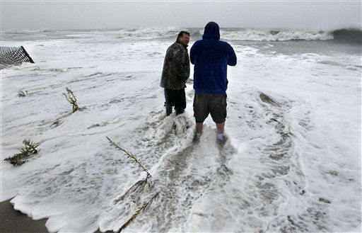 Life long Cape May residents Andy Becica, left, and Peter Wilson stand in rough surf along the Atalantic Ocean Monday morning, Oct. 29, 2012, in Cape May, N.J., as high tide and Hurricane Sandy begin to arrive. Becica said this was the worst he&#39;s seen the ocean. With Hurricane Sandy poised to make a direct hit on New Jersey, Gov. Chris Christie has issued a typically blunt warning to those thinking of riding it out in low-lying coastal areas: &#34;Don&#39;t be stupid. Get out.&#34; The storm was still hundreds of miles away, but was already making its approach known to New Jersey on Sunday with high winds, rough surf and coastal flooding as thousands of people fled to what they hoped would be safer ground.  <span class=meta>(AP Photo&#47; Mel Evans)</span>