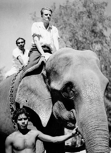 American evangelist Billy Graham rides an Indian elephant in Kottayam, southern India, Feb. 1, 1956. <span class=meta>(AP Photo)</span>