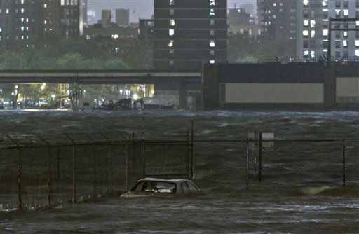 A car is submerged in the Dumbo section of the Brooklyn borough of New York, as the East River overflows during hurricane Sandy, on Monday, Oct. 29, 2012.  Authorities warned that New York City and Long Island could get the worst of the storm surge: an 11-foot onslaught of seawater that could swamp lower  areas of the city.  <span class=meta>(AP Photo&#47; Bebeto Matthews)</span>