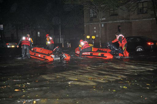 FDNY inflatable boats travel along 14th street towards the East River on a rescue mission in the wake of Hurricane Sandy, Monday, Oct. 29, 2012, in New York. Sandy continued on its path Monday, as the storm forced the shutdown of mass transit, schools and financial markets, sending coastal residents fleeing, and threatening a dangerous mix of high winds and soaking rain.  <span class=meta>(AP Photo&#47; Louis Lanzano)</span>