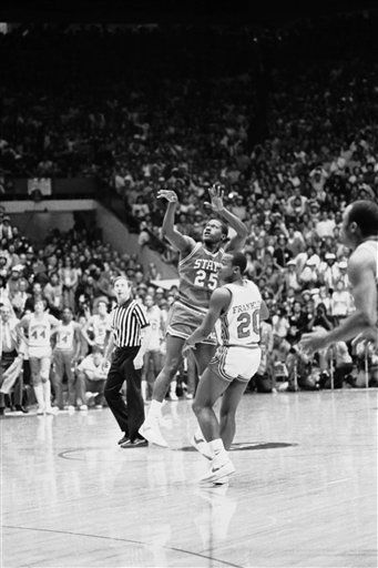 Dereck Whittenburg &#40;25&#41; makes the shot which was to be dunked a spilt second later by Lorenzo Charles of N.C. State to win the game over Houston, April 4, 1983, Albuquerque, N.M. <span class=meta>(AP Photo)</span>
