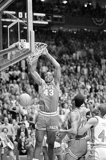 North Carolina State&#39;s Lorenzo Charles &#40;43&#41; dunks the ball in the basket to give N.C. State a 54-52 win over Houston in the NCAA Championship game in Albuquerque, N.M., April 4, 1983. <span class=meta>(AP Photo)</span>