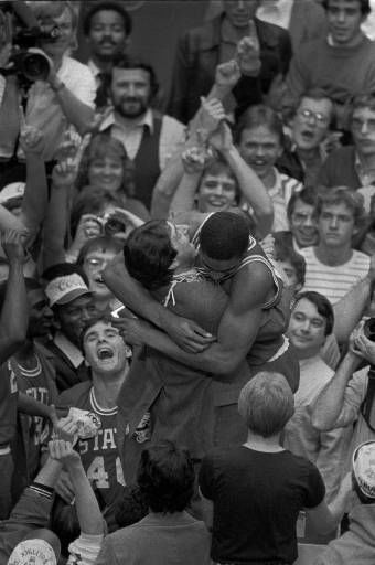 North Carolina State coach Jim Valvano embraces sophomore forward Lorenzo Charles moments after Charles had dunked a shot to give North Carolina State the win over Houston April 5, 1983 in the NCAA final at Albuquerque. <span class=meta>(AP Photo)</span>