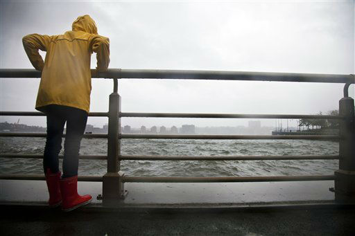 Sadie Stern looks out over the choppy Hudson River from a pier along the Hudson River Greenway, Monday, Oct. 29, 2012, in New York. Hurricane Sandy continued on its path Monday, forcing the shutdown of mass transit, schools and financial markets, sending coastal residents fleeing, and threatening a dangerous mix of high winds and soaking rain.  <span class=meta>(AP Photo&#47; CX Matiash)</span>