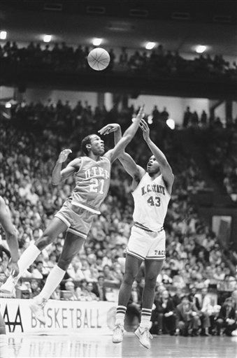 Lorenzo Charles &#40;43&#41; of North Carolina State takes a shot over the head of Juden Smith of Univ. of Texas-El Paso during the second half of their NCAA west in Albuquerque on March 18, 1985. Charles scored 30 points of lead North Carolina State to a 86-73 win over Texas-El Paso. <span class=meta>(AP Photo)</span>