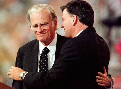 Rev. Billy Graham and his son, Franklin Graham embrace during the last night of the Carolinas Billy Graham Crusade at Ericsson Stadium in Charlotte, N.C., Sunday, Sept. 29, 1996. Many expect this to be Rev. Graham&#39;s last crusade in North Carolina. <span class=meta>(AP Photo&#47;Peter A. Harris)</span>