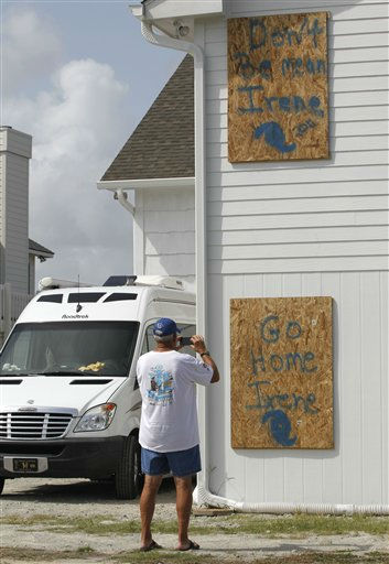 "<div class=""meta image-caption""><div class=""origin-logo origin-image ""><span></span></div><span class=""caption-text"">John Oliver takes photos of his boarded up home in Atlantic Beach, N.C., Thursday, Aug. 25, 2011 as Hurricane Irene heads toward the North Carolina coast. Oliver, who was taking the photos for insurance purposes, plans on leaving Friday morning and staying with friends in Greensboro, N.C.  (AP Photo/ Chuck Burton)</span></div>"