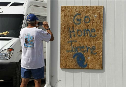 John Oliver takes photos of his boarded up home in Atlantic Beach, N.C., Thursday, Aug. 25, 2011 as Hurricane Irene heads toward the North Carolina coast. Oliver, who was taking the photos for insurance purposes, plans on leaving Friday morning and staying with friends in Greensboro, N.C.  <span class=meta>(AP Photo&#47; Chuck Burton)</span>