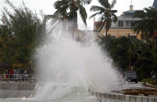 A wave washes over a road in the aftermath of Hurricane Irene in Nassau, on New Providence Island in the Bahamas, Thursday, Aug. 25, 2011. Irene hit Nassau with tropical storm strength winds as it passed to the east.   <span class=meta>(AP Photo&#47; Lynne Sladky)</span>