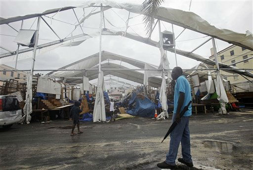 "<div class=""meta image-caption""><div class=""origin-logo origin-image ""><span></span></div><span class=""caption-text"">Shop owner Larry McDonald looks at the Straw Market which was damage by the effects of Hurricane Irene in Nassau on New Providence Island in the Bahamas, Thursday Aug. 25, 2011. McDonald has a stall at the market selling wood carvings, which he said was not damaged. Irene is pounding the Bahamas as a Category 3 hurricane.  (AP Photo/ Lynne Sladky)</span></div>"
