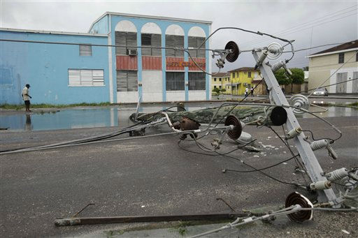 A man walks past a downed power line in the aftermath of Hurricane Irene in Nassau, on New Providence Island in the Bahamas, Thursday, Aug. 25, 2011. Irene hit Nassau with tropical storm strength winds as it passed to the east.  <span class=meta>(AP Photo&#47; Lynne Sladky)</span>