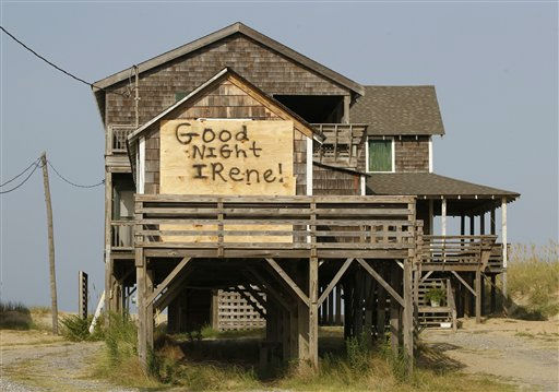 A boarded up house is left with a message for Hurricane Irene in anticipation of her arrival in Nags Head, N.C., Thursday, Aug. 25, 2011 on North Carolina&#39;s Outer Banks. Forecasters at the National Hurricane Center Thursday afternoon  issued the first warnings for the entire North Carolina coast to the Virginia border. One is also out for the coast of South Carolina from Edisto Beach north.  <span class=meta>(AP Photo&#47; Charles Dharapak)</span>