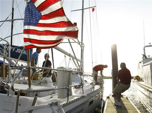 Rick Perkins, right, tugs a line as he secures his boat in preparation for the arrival of Hurricane Irene in the Willoughby Spit area of  Norfolk, Va., Thursday, Aug. 25, 2011. <span class=meta>(AP Photo&#47; Steve Helber)</span>