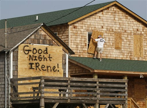 "<div class=""meta ""><span class=""caption-text "">A message is left for Hurricane Irene on one house, left, as a resident boards up another in anticipation of the arrival of Hurricane Irene in Nags Head, N.C., Thursday, Aug. 25, 2011 on North Carolina's Outer Banks.  (AP Photo/ Charles Dharapak)</span></div>"