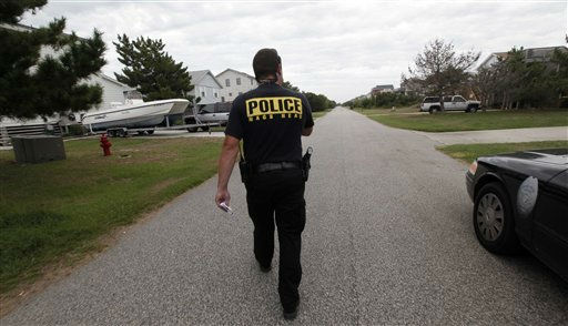 "<div class=""meta image-caption""><div class=""origin-logo origin-image ""><span></span></div><span class=""caption-text"">Nags Head police officer Edward Mann goes door to door speaking with those who did not evacuate about Hurricane Irene as it approaches the North Carolina Outer Banks in Nags Head, N.C., Friday, Aug. 26, 2011. Mann was warning residents who have not evacuated that assistance will be limited after the storm winds reach 60 miles per hour.  (AP Photo/ Gerry Broome)</span></div>"