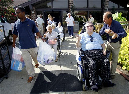 "<div class=""meta ""><span class=""caption-text "">Sentara Nursing Center Currituck resident J.T Campbell, second from right, waits to be evacuated in response to a mandatory evacuation order in Barco, N.C., Friday, Aug. 26, 2011, as Hurricane Irene heads toward the North Carolina coast. Most of the residents will be moved to other Sentara Life Care facilities in Hampton Roads, Virginia. (AP Photo/ Jim R. Bounds)</span></div>"