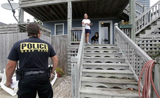 Nags Head police officer Edward Mann speaks with resident Debbie Hickey about Hurricane Irene as it approaches the Outer Banks in Nags Head, N.C., Friday, Aug. 26, 2011. Mann was warning residents who have not evacuated that assistance will be limited after the storm winds reach 60 miles per hour. <span class=meta>(AP Photo&#47; Gerry Broome)</span>