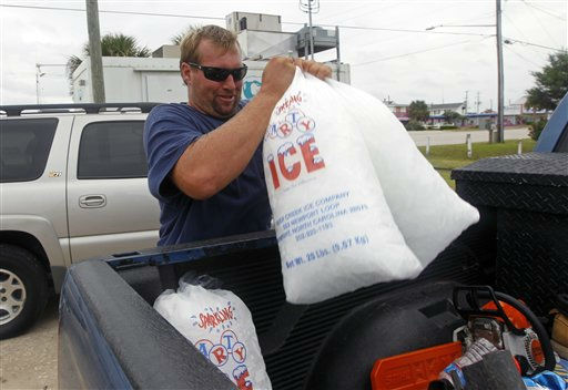 Mike Small, of Morehead City, N.C., loads bags of ice into his truck in Atlantic Beach, N.C., Friday, Aug. 26, 2011 as Hurricane Irene heads toward the North Carolina coast. Hurricane warnings remained in effect from North Carolina to New Jersey. Hurricane watches were in effect even farther north and included Long Island, Martha&#39;s Vineyard and Nantucket, Mass.  <span class=meta>(AP Photo&#47; Chuck Burton)</span>