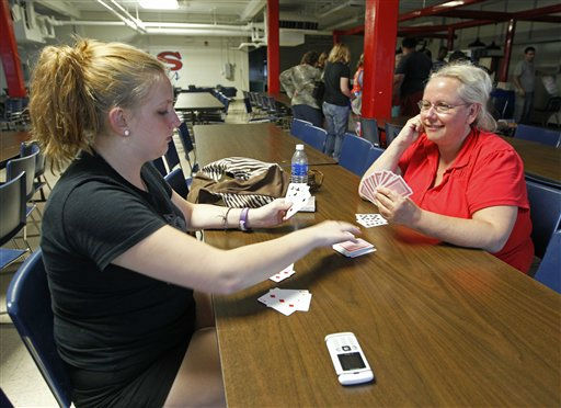 Emily Kolbe, left, plays cards with her mother Michelle Kolbe, right, at an emergency shelter in Morehead City, N.C., Friday, Aug. 26, 2011 as Hurricane Irene heads toward the North Carolina coast.  <span class=meta>(AP Photo&#47; Chuck Burton)</span>