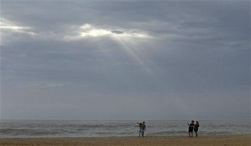 "<div class=""meta ""><span class=""caption-text "">Beachgoers take photos in Nags Head, N.C., Friday, Aug. 26, 2011 as hurricane Irene takes aim at the North Carolina coast. A mandatory evacuation is underway for the immediate area.  (AP Photo/ Gerry Broome)</span></div>"