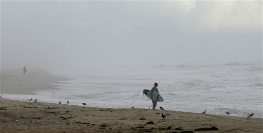 A lone surfer looks out over the ocean in Nags Head, N.C., Friday, Aug. 26, 2011 as hurricane Irene takes aim at the North Carolina coast. A mandatory evacuation is underway for the immediate area. <span class=meta>(AP Photo&#47; Gerry Broome)</span>