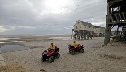 Nags Head Ocean Rescue lifeguards Ben Mechak, left, and Erika Audfroid patrol the beach in Nags Head, N.C., Friday, Aug. 26, 2011 as hurricane Irene takes aim at the North Carolina coast. A mandatory evacuation is underway for the immediate area.  <span class=meta>(AP Photo&#47; Gerry Broome)</span>