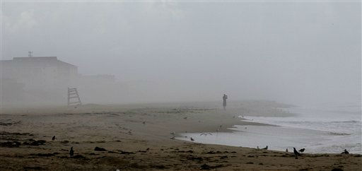 A lone beachgoer is seen in Nags Head, N.C., Friday, Aug. 26, 2011 after evacuations in preparation for Hurricane Irene have left the area mostly deserted. The full force of Hurricane Irene was still a day away from the East Coast but heightened waves began hitting North Carolina&#39;s Outer Banks early Friday.  <span class=meta>(AP Photo&#47; Gerry Broome)</span>