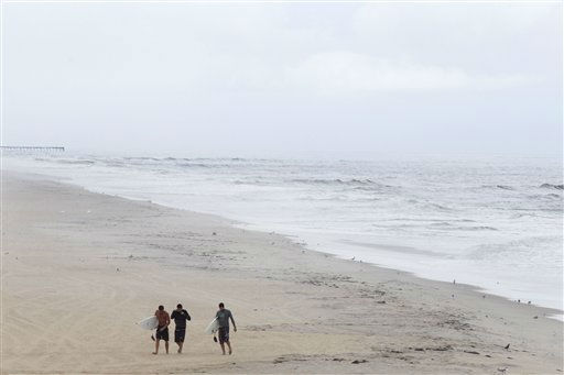 With mandatory evacuations for visitors and residents in place before the arrival of Hurricane Irene, a beach is largely deserted as surfers walk away from the water in Nags Head, N.C., Friday, Aug. 26, 2011 on North Carolina&#39;s Outer Banks.  <span class=meta>(AP Photo&#47; Charles Dharapak)</span>