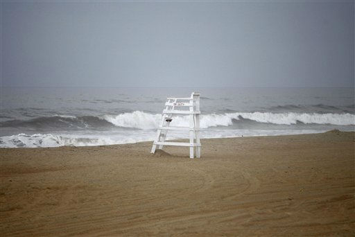 With mandatory evacuations for visitors and residents in place before the arrival of Hurricane Irene, an empty life guard chair with the words &#34;Off Duty&#34; is seen on a deserted beach in Nags Head, N.C., Friday, Aug. 26, 2011 on North Carolina&#39;s Outer Banks.  <span class=meta>(AP Photo&#47; Charles Dharapak)</span>