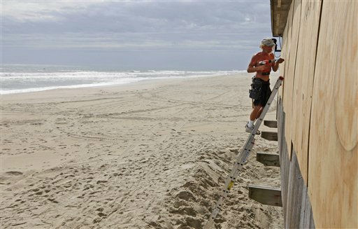 With a mandatory evacuation in place, the beach is deserted as Brad Bradley boards up the windows of a restaurant in anticipation of the arrival of Hurricane Irene in Nags Head, N.C., Friday, Aug. 26, 2011 on North Carolina&#39;s Outer Banks.  <span class=meta>(AP Photo&#47; Charles Dharapak)</span>