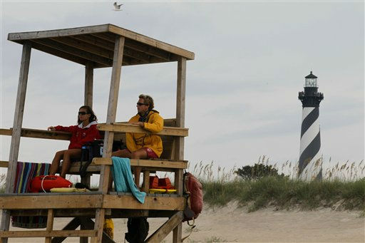 "<div class=""meta ""><span class=""caption-text "">Lifeguards keep watch over the beach along the Cape Hatteras National Seashore in Buxton, N.C., Wednesday, Aug. 24, 2011. As Hurricane Irene strengthened to a major Category 3 storm over the Bahamas Wednesday, it continues to threaten much of the east coast as it is expected to get stronger over warm ocean waters and could become a Category 4 storm with winds of at least 131 mph (211 kph) by Thursday.  (AP Photo)</span></div>"