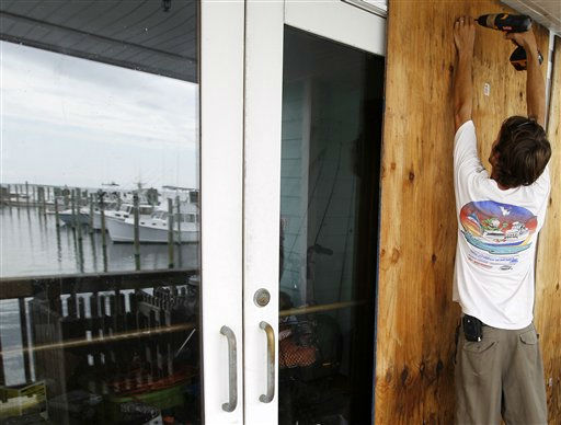 Jeremy Pickett boards the windows of a shopping store in Cape Hatteras, N.C. in preparation for Hurricane Irene on Wednesday, Aug. 24, 2011. Evacuations began on Ocracoke Island off North Carolina as Hurricane Irene strengthened to a major Category 3 storm over the Bahamas on Wednesday with the East Coast in its sights. <span class=meta>(AP Photo)</span>