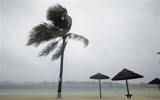 Palm trees blow on an empty beach as bands of rain and wind from Hurricane Irene hit Nassau, on New Providence Island in the Bahamas, Wednesday, Aug. 24, 2011. Hubert Ingraham, the prime minister of the Bahamas says Hurricane Irene has caused isolated damage on its march up the island chain but so far no deaths or injuries.  <span class=meta>(AP Photo)</span>