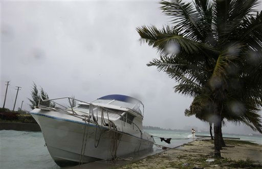 A boat hits against the seawall as bands of rain and wind from Hurricane Irene hit Nassau, on New Providence Island in the Bahamas, Wednesday, Aug. 24, 2011. Hubert Ingraham, the prime minister of the Bahamas says Hurricane Irene has caused isolated damage on its march up the island chain but so far no deaths or injuries. <span class=meta>(AP Photo)</span>