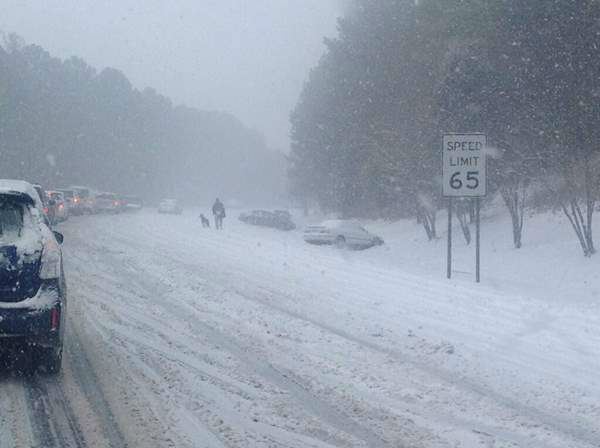A winter storm snarled traffic and spawned dramatic scenes on roads around central North Carolina Wednesday. Many Good Samaritans and emergency workers came to the rescue of stranded drivers. <span class=meta>(WTVD Photo)</span>