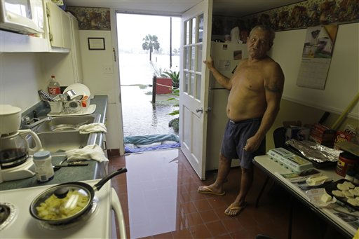 Jackie Woody looks over his flooded kitchen in Carolina Beach, N.C., Thursday, Sept. 30, 2010.  <span class=meta>(AP Photo&#47; Chuck Burton)</span>