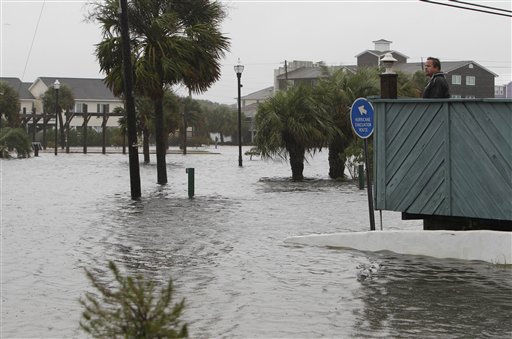 "<div class=""meta ""><span class=""caption-text "">Jerry Pond, of Myrtle Beach, S.C., looks out at the flood waters in Carolina Beach, N.C., Thursday, Sept. 30, 2010.  (AP Photo/ Chuck Burton)</span></div>"