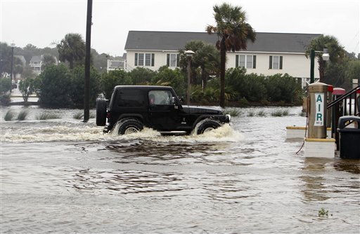 "<div class=""meta ""><span class=""caption-text "">A drives makes his way through a flooded street in Carolina Beach, N.C., Thursday, Sept. 30, 2010.  (AP Photo/ Chuck Burton)</span></div>"
