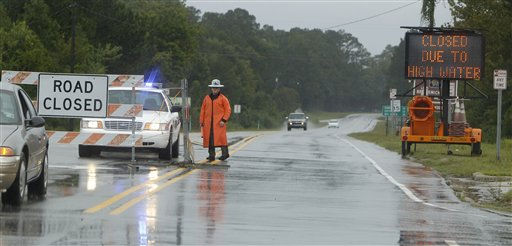 "<div class=""meta ""><span class=""caption-text "">A Brunswick County Sheriff's deputy stands at a closed section of Highway 133 in Leland, N.C., Thursday, Sept. 30, 2010.  (AP Photo/ Chuck Burton)</span></div>"