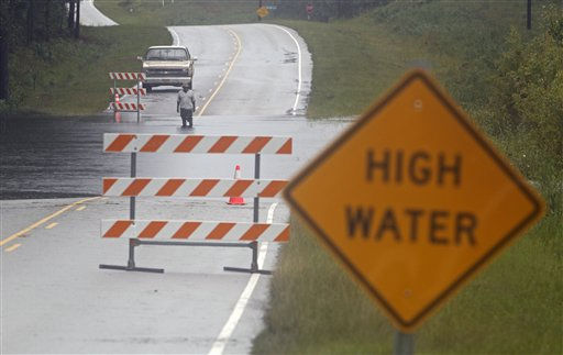 A man checks the depth of flood waters on Highway 133 in Leland, N.C., Thursday, Sept. 30, 2010.  <span class=meta>(AP Photo&#47; Chuck Burton)</span>