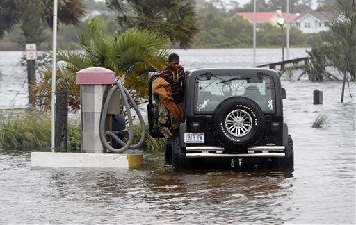 A man cleans his car at a flooded car wash in Carolina Beach, N.C., Thursday, Sept. 30, 2010.  <span class=meta>(AP Photo&#47; Chuck Burton)</span>