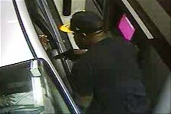 Fayetteville police need help identifying this man who allegedly robbed an ATM customer at gunpoint in the drive through of the BB&#38;T Bank at 2507 Bragg Boulevard around 9 p.m. March 25. Anyone with information is asked to call the Fayetteville Police Department at &#40;910&#41; 433-1856 or CrimeStoppers at &#40;910&#41; 483-TIPS &#40;8477&#41;.  <span class=meta>(Photo&#47;Surveillance Photo)</span>