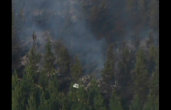 "<div class=""meta ""><span class=""caption-text "">Fire crews fought a 25 acre woods fire in northern Durham County Monday. It broke out near Johnson Mill Road in Bahama. (Photo/WTVD Photo)</span></div>"