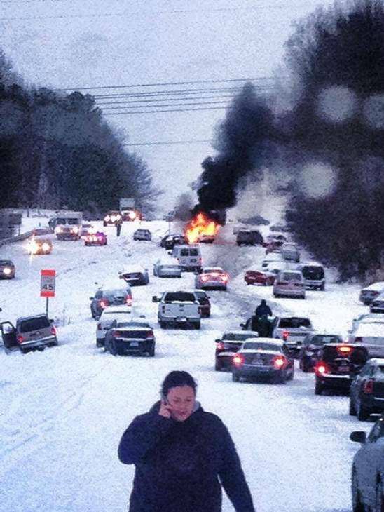 "<div class=""meta ""><span class=""caption-text "">A winter storm snarled traffic and spawned dramatic scenes on roads around central North Carolina Wednesday. Many Good Samaritans and emergency workers came to the rescue of stranded drivers. (WTVD iWitness Photo)</span></div>"