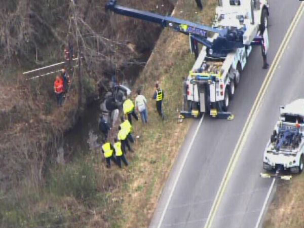 Emergency workers pulled an upside down car out of a creek in Durham Wednesday