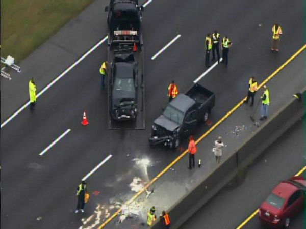 A multi-car pileup on I-40 east blocked all lanes of the interstate near the NC 55 exit. At least one vehicle caught fire. <span class=meta>(WTVD Photo)</span>
